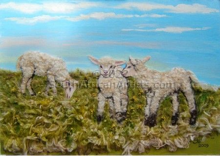 Three lambs frollicking in the grass
